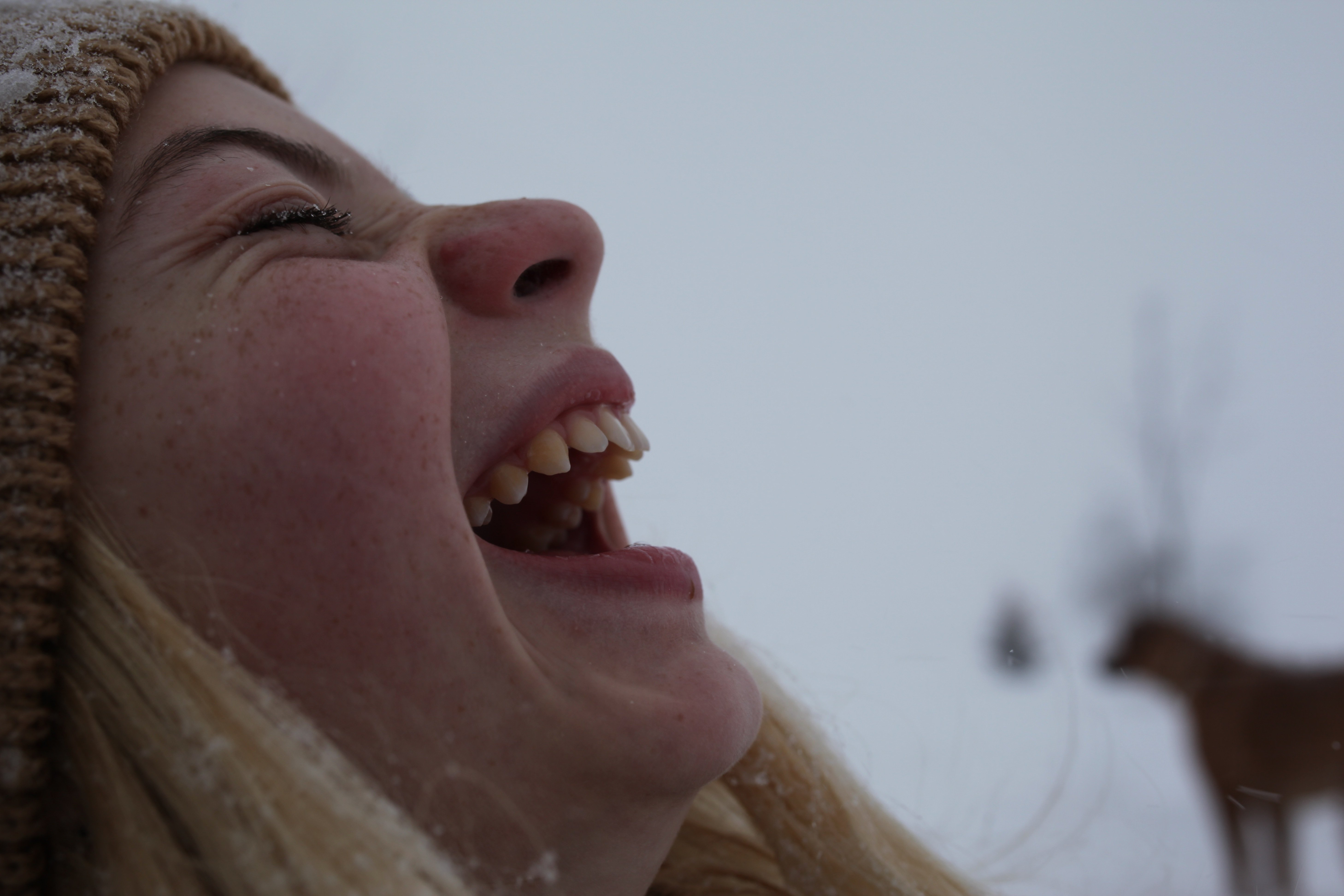 Taylor laughing in snow