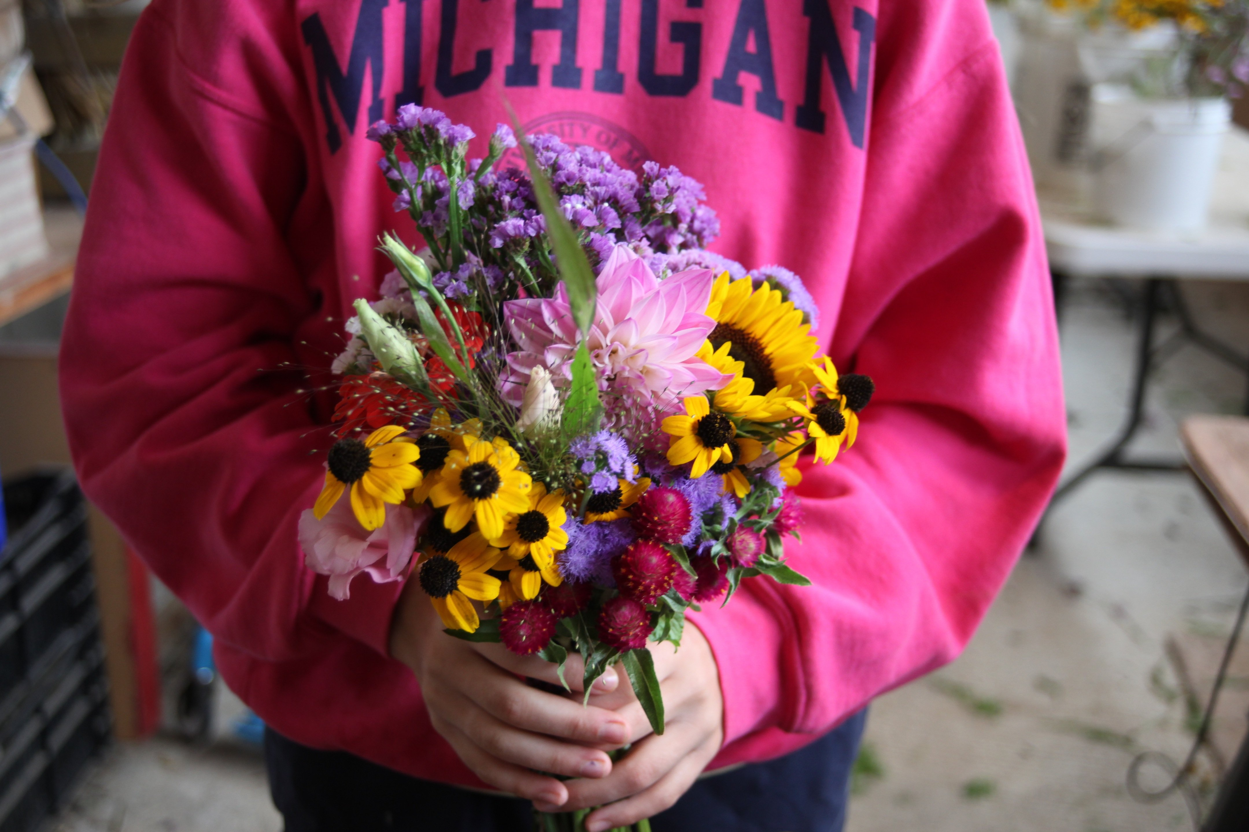 cody holding fall bouquet