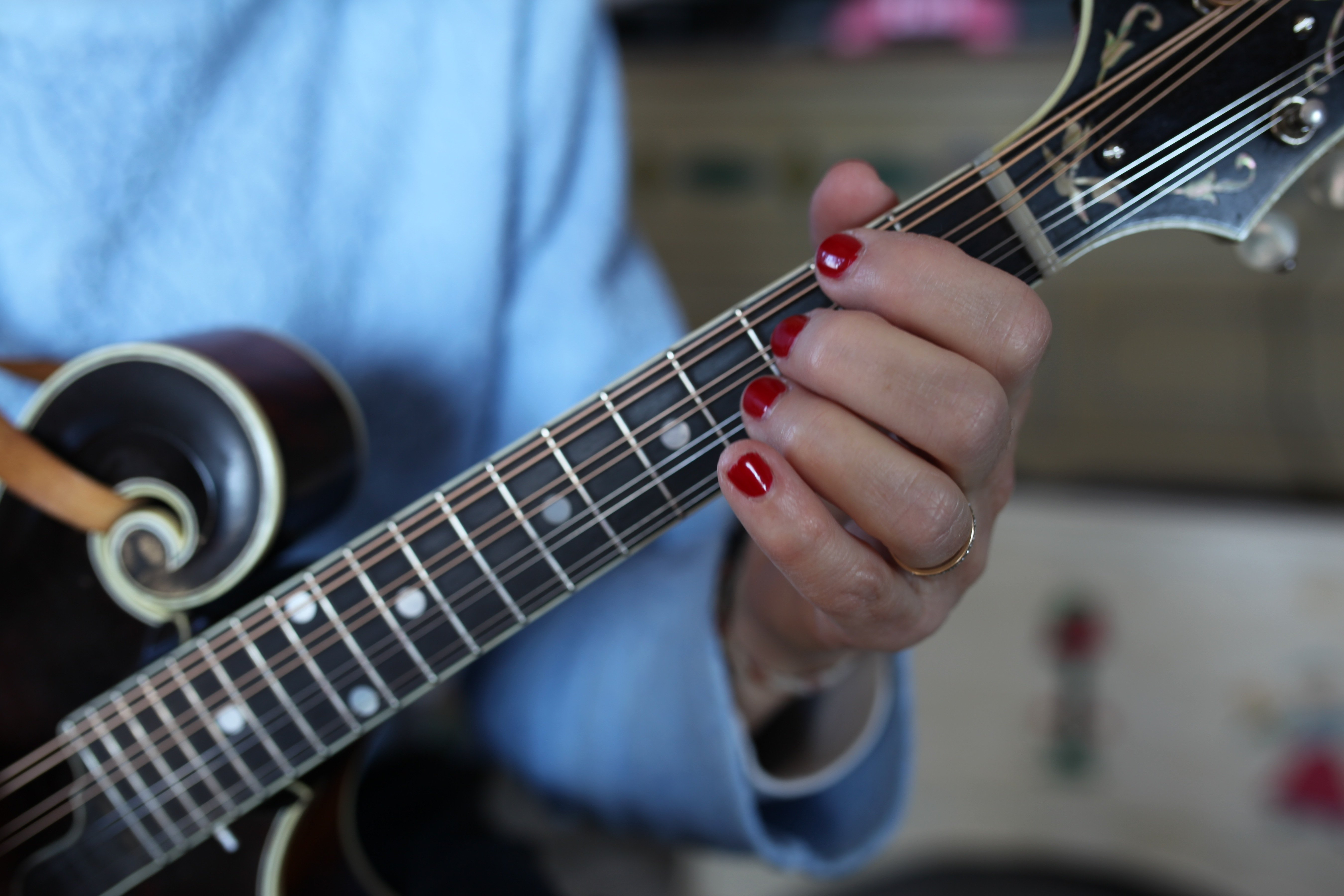 playing mandolin w: red nails