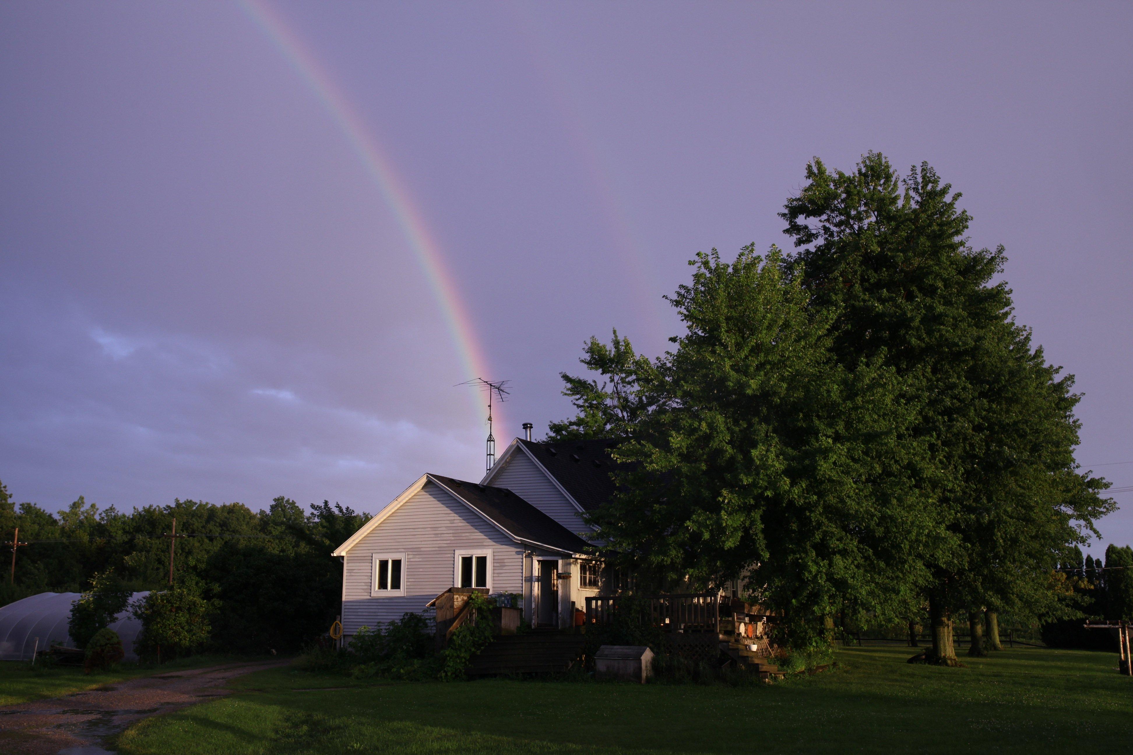 rainbow over farmhse
